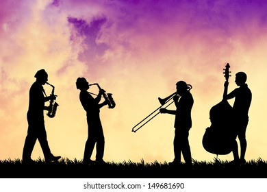 Musician at sunset