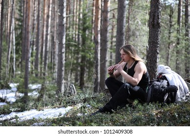 A musician with a tool in nature. Man is playing a flute in a pine forest. The music of the druids in the spring forest.