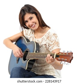 Musician woman playing guitar in a course isolated on a white background