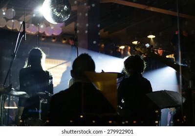 Musicians band playing in modern bar - restaurant