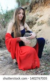 Musicians or beautiful women outdoor. Nature, meditation. Listen to your heart. A drum, darbuka, djembe, play the drum, rhythm, wildlife, play a musical instrument, music.