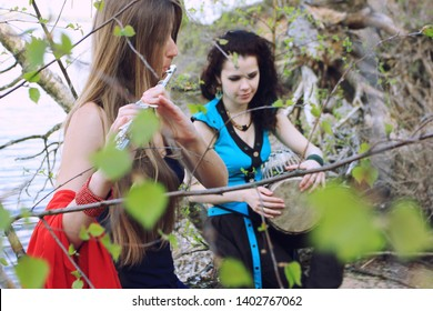 Musicians or beautiful women outdoor. Nature, meditation. Listen to your heart. A drum, darbuka, djembe, play the drum, rhythm, wildlife, play a musical instrument. Unity with nature, love.