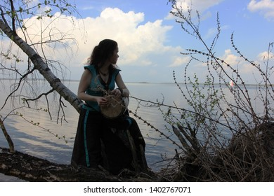 Musicians or beautiful women outdoor. Nature, meditation. Listen to your heart. A drum, darbuka, djembe, play the drum, rhythm, wildlife, play a musical instrument, musc. Unity with nature.