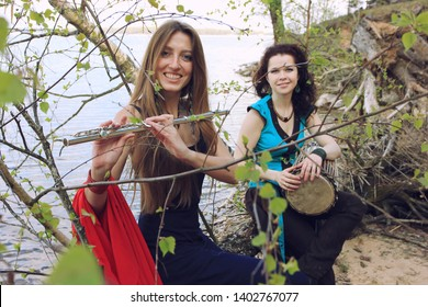 Musicians or beautiful women outdoor. Nature, meditation. Listen to your heart. A drum, darbuka, djembe, play the drum, rhythm, wildlife, play a musical instrument, music. Be happy. Be free, love.