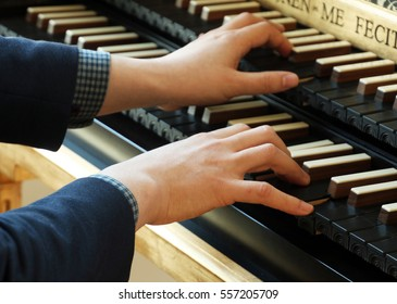 Musician's delicate touch to play harpsichord (selective focus)