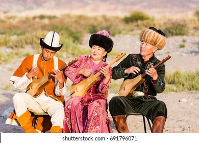 Musicians play traditional instruments in Issyk Kul, Kyrgyzstan on May 28, 2017