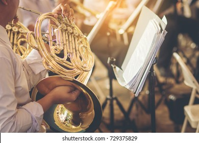 musicians playing french horn practice for show in music band.