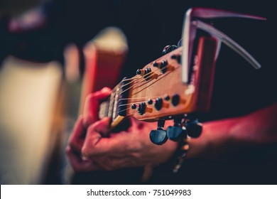 musicians playing guitar.