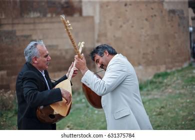 Musicians Playing  Saz or Baglama-Traditional Anatolian Music Instruments ,Kars-Turkey 14-10-2009