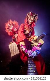 Musicians in Venetian masquerade costumes. Guitarist romantic.
