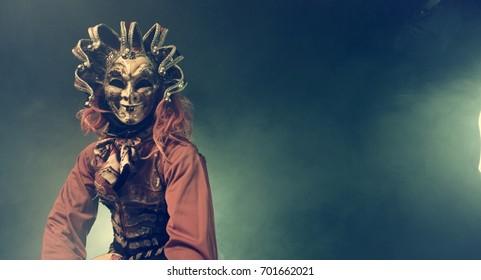 Musicians in Venetian masquerade costumes. Romantic guitarist.