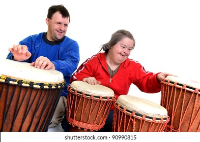 musictherapy -couple with down syndrome playing on djembe