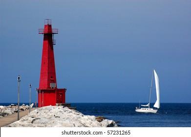 Muskegon lighthouse and sailboat, lake Michigan, Muskegon, MI