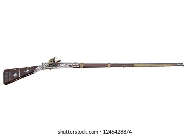 Musket decorated with bone and brass. Old flintlock rifle.