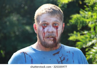 MUSKOGEE, OK - Sept. 12: An male actor pretending to be a zombie poses for a picture during the Castle Zombie Run at the Castle of Muskogee in Muskogee, OK on September 12, 2015.