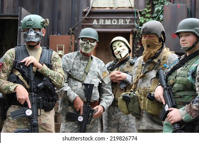 MUSKOGEE, OK - Sept. 13: Soldiers dressed in camouflage are ready to hunt zombies during the Castle Zombie Run at the Castle of Muskogee in Muskogee, OK on September 13, 2014.