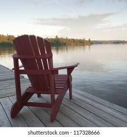 Muskoka chair on dock at Lake of the Woods, Ontario