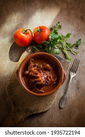 musky otopus with tomato sauce and parsley - Shutterstock ID 1935722194