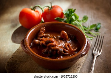 musky otopus with tomato sauce and parsley - Shutterstock ID 1935722200