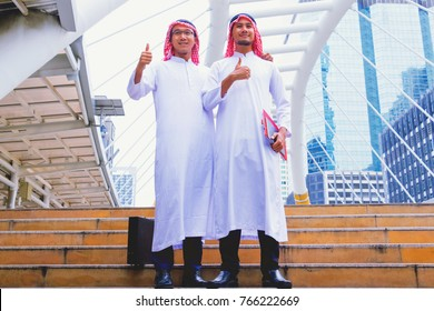 Muslim  Arab man.They are show hands and back in town. Bangkok  Thailand.