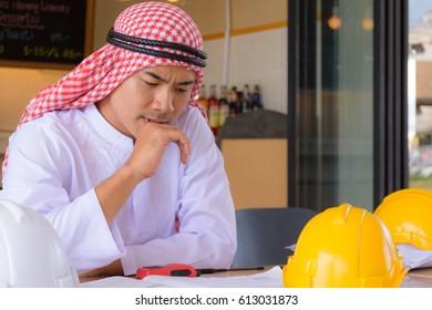 Muslim, Arabian business have working in cafe, coffee shop.
