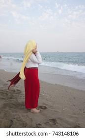 Muslim Arabic girl on vacation enjoying sea beach sunset
