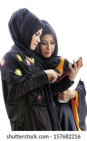 Muslim asian female student with tablet computer