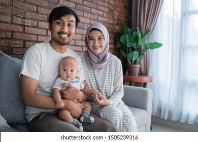 muslim asian parent playing at home with their baby