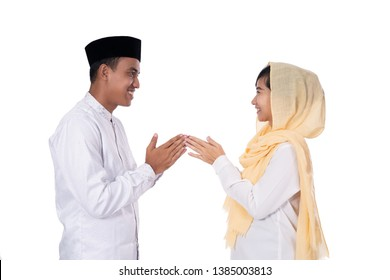 muslim asian people forgiving on eid mubarak tradition. apologizing each other isolated over white