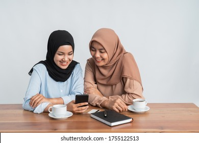 muslim bestfriend gossiping on social media using mobile phone