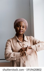 Muslim black girl on white background. African business woman in studio. Model posing. Advert for banking and islamic social media