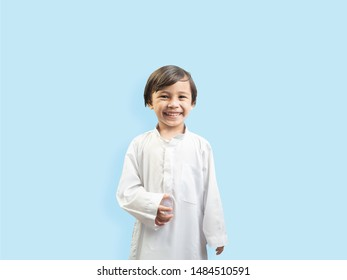 Muslim boy in a dress , isolate background