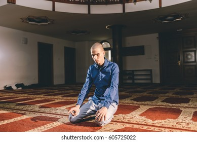 Muslim boy kneeling humbly in prayer