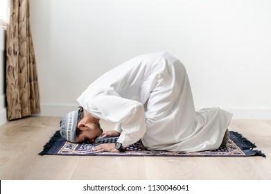 Muslim boy praying in Sujud posture