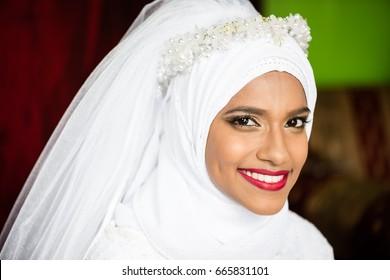 Muslim bride young beautiful beauty white wedding dress headscarf portrait smile
