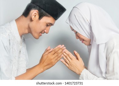 Muslim brother & sister greet each other and ask forgiveness in eid mubarak / Ied Fitr celebration