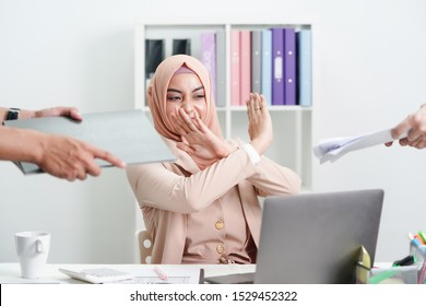 Muslim business lady being scared and shocked because of too much paperwork to do. Business unhappy concept.