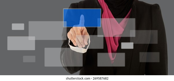 Muslim Businesswoman standing selecting square from touchscreen interface