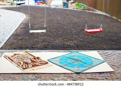 Muslim carpet mats lay outside in backyard ready for pray after Kurban Bairam holiday
