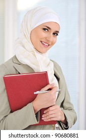 Muslim Caucasian female student with notebook and pen
