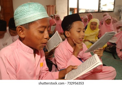 Muslim children learn Quran at Madrasah School in Rungkut, Surabaya, East Java, Indonesia on November 7, 2003