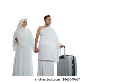 muslim couples wife and husband wearing white traditional clothes for Ihram ready for Hajj