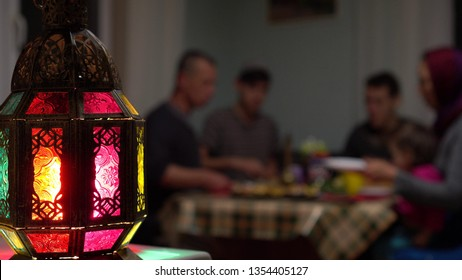 Muslim Family Eating Dinner At Home. Ramadan is a time when families get together in the evening to break their fast