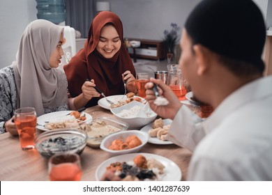 muslim family enjoy the iftar meal dinner together in dining room