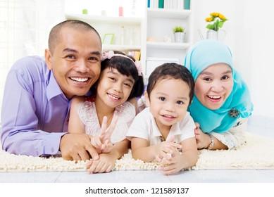 muslim family lying on the floor