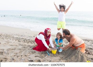 Muslim family on beach