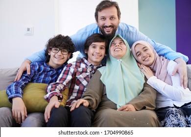 muslim family portrait with arab  teenage kids at modern home interior