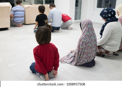 Muslim family praying together at home