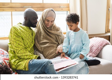 Muslim family seating on the sofa in a living room