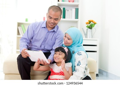 muslim family using tablet computer